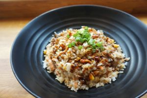 cooked rice on black ceramic plate 723198
