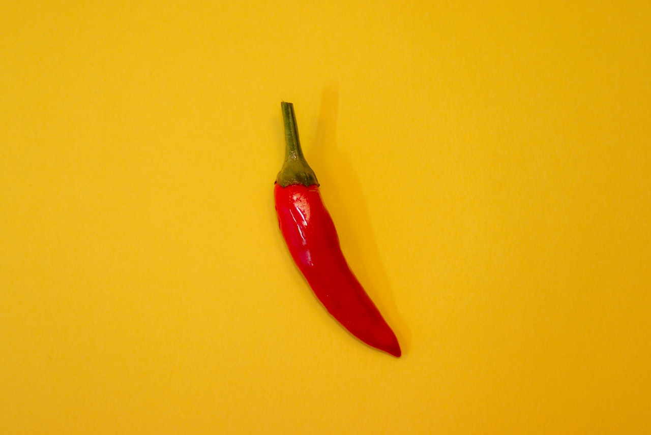 red chili on yellow surface 3194495